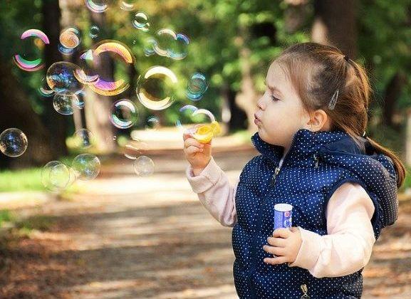Child blow bubbles image